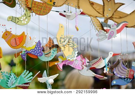 Cute Colorful Wooden Birds Sold On Easter Market In Vilnius. Lithuanian Capital's Traditional Crafts