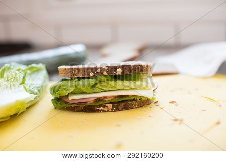 Sandwich With Ham, Cheese, Cucmber And Lettuce