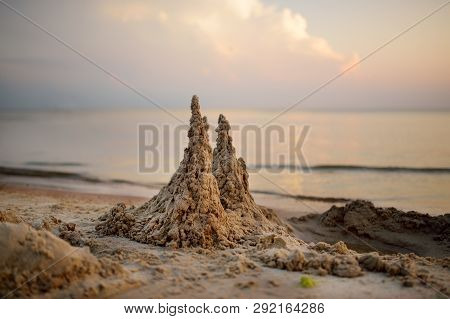 Sand Castle Built On The Beach Of Baltic Sea On Beautiful Summer Evening. Travel Vacations Concept.