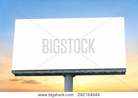 Billboard - Large Blank Billboard With Empty Screen And Beautiful Cloudy Sky For Outdoor Advertising