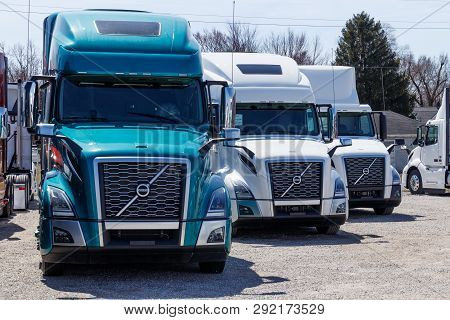 Muncie - Circa March 2019: Colorful Volvo Semi Tractor Trailer Trucks Lined Up For Sale. Volvo Is On