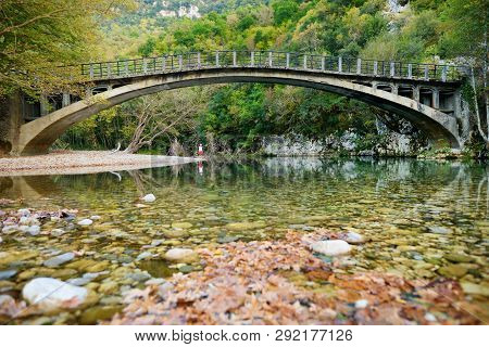 Traditional Arched Stone Bridge Of Zagori Region In Northern Greece. Iconic Bridges Were Mostly Buil