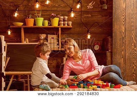 Cooperation Concept. Mother And Son Cooperate In Building Structure Model, Cooperation. Cooperation