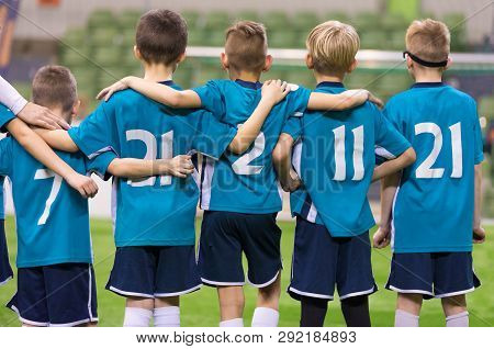 Young Football Players. Young Soccer Team Supporting Friends During Penalty Kicks. Soccer Match For