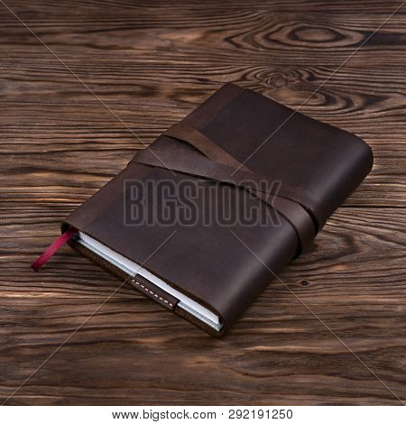 Brown Handmade Leather Notebook Cover With Notebook Inside On Wooden Background. Stock Photo Of Luxu