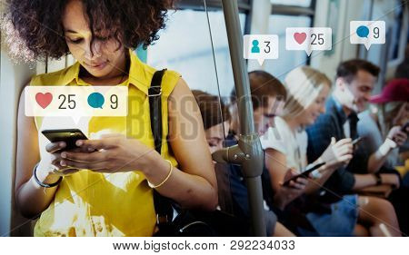 People using social media on their smartphones in the subway
