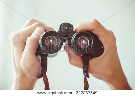 Portrait Of A Young Man With Binoculars