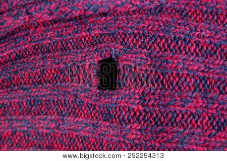Red Woolen Fabric Texture With A Hole