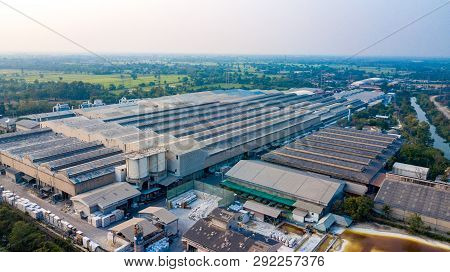 Surface Of Factory Warehouse Roof From Drone Aerial View.