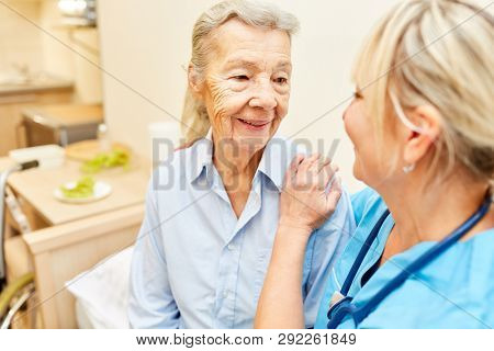 Caregiver gently caresses a senior citizen in a nursing home or home visit