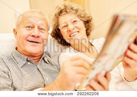 Vital senior couple in the senior citizen's home enjoys the memory training