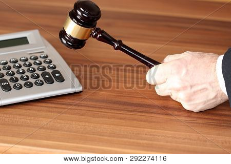 Calculate And Dicision With Gavel And Woooden Background