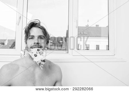 Man Bearded Handsome Eat Pizza. Sexy Courier Delivers Gastronomic Satisfaction. Guy Naked Holds Slic