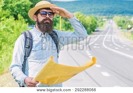 Any Transport. Traveler With Map Looking For Hitchhiking Transportation Alone At Edge Of Road. Tips