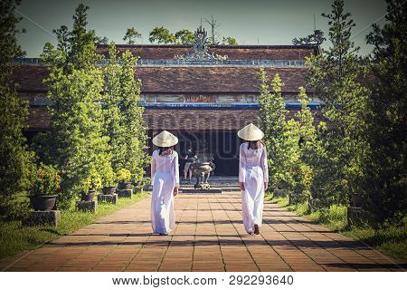 Beautiful woman with  Ao dai vintage style. Beautiful girl with Vietnam culture traditional dress, Life of Vietnamese. Ao dai is a traditional costume famous Ho Chi Minh Vietnam.Hoi an Vietnam. poster