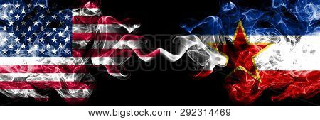 United States Of America Vs Yugoslavia Smoky Mystic Flags Placed Side By Side. Thick Colored Silky S