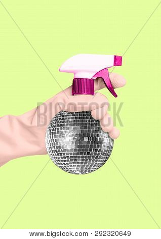 An Alternative Cleaning - Disco Spraing Bottle. Hand In A Housewifely White Glove Holding Spray As A