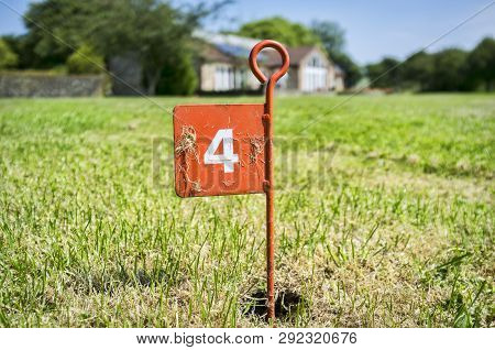 Golf Pitch And Putt Hole Flag On Lawn