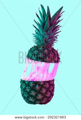 A Paradox. An Alternative Colorful Pineapple Filled With Cream Or Pink Bubblegym Against Blue Backgr