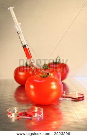Close-Up Of Syringe In Tomato