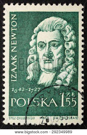 Fort Collins, CO, USA - March 19, 2019:   Isaac Newton,  English mathematician, physicist, astronomer, portrait on a vintage, canceled post stamp from Poland (circa 1959).