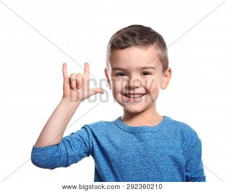 Little Boy Showing I Love You Gesture In Sign Language On White Background