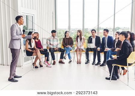 Businessman Standing In Front Of Group Of People In Consulting Meeting Conference Seminar At Hall Or