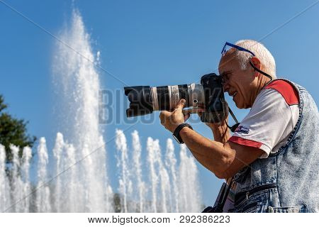 Milan, Lombardy, Italy - Sep 24, 2016: Male Photographer With Professional Equipment (canon Eos Mark