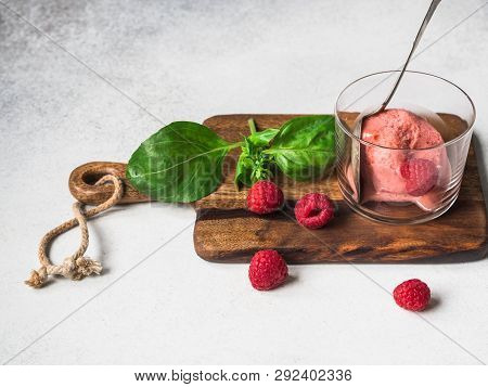Fresh Homemade Sorbet Basil And Strawberries In Glass, Vintage Spoon And Fresh Berries On Wood Board