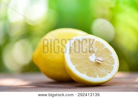 Lemon Slice Close Up And Lemon Fruit On Summer Nature Background
