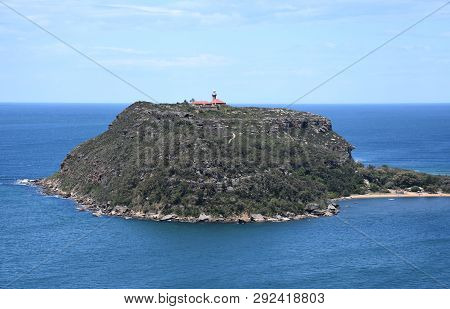 View Of Barrenjoey Lighthouse On The Top Of Barrenjoey Head At The End Of Palm Beach From West Head