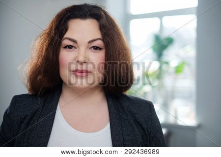 Portrait of a cheerful plus size model