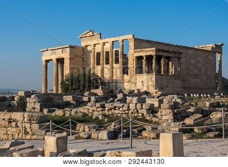 View of Erechtheion and porch of Caryatids on Acropolis in Athens, Greece, against sunset poster