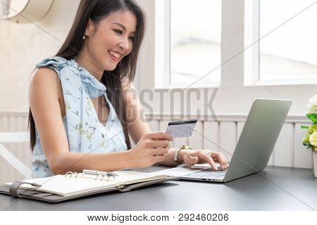 Freelancer Business Woman Holding Credit Cart To Shopping Online With Computer Laptop In Cafe.