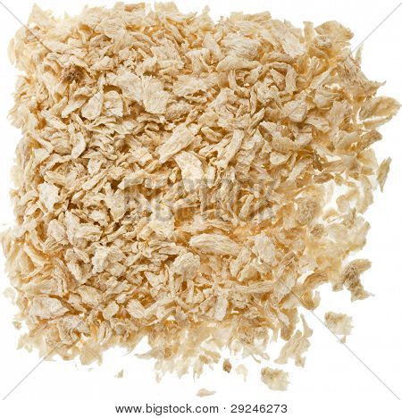 pile raw soy flakes on white poster