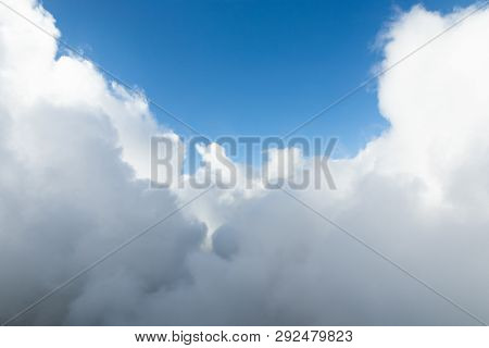White Clouds Surrounding Blue Sky