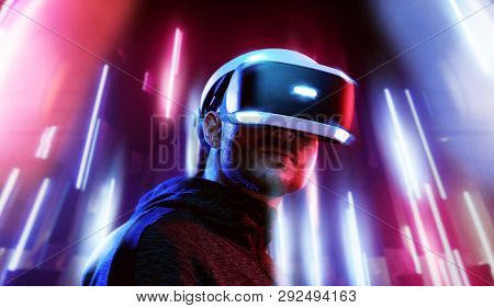 Model young man with beard in glasses of virtual reality. Augmented reality, science, future technol