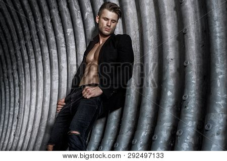 Muscular Young Man With Beard On Dark Tunnel Urban Background. Fashion Portrait Of Brutal Strong Mus
