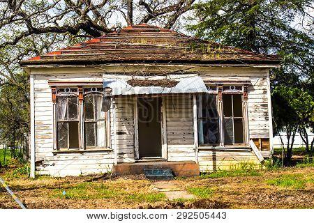 Old Abandoned Uninhabitable Single Story House In Disrepair