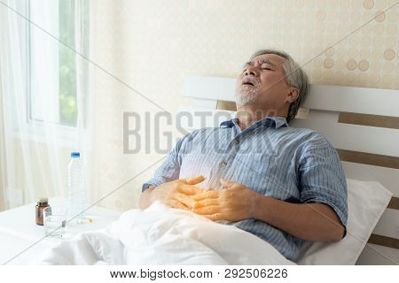 Senior Male Asian Suffering From Bad Pain In His Have A Stomachache At Home - Senior Healthcare Conc
