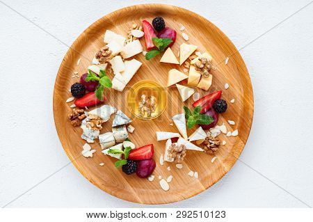 Cheese Plate. Banquet, Restaurant Menu. Slices Of Various Cheeses. Camembert, Parmesan, Dorblu And M