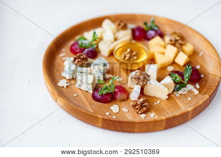 Different Types Of Cheeses. Slices Of Cheese Camembert With Parmesan, Dorblu And Maasdam Served With