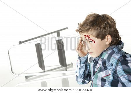 Frightened Boy With Bleeding Forehead