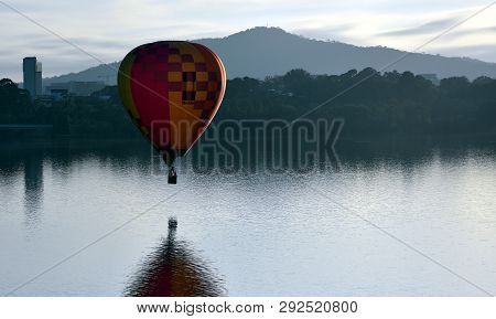 Canberra, Australia - March 10, 2019. Hot Air Balloon Flying In The Air Above Lake Burley Griffin, A