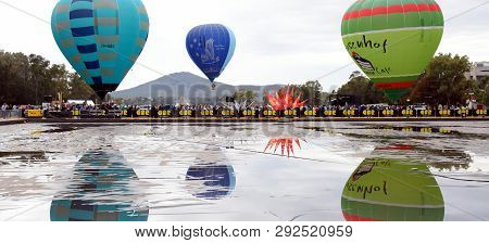 Canberra, Australia - March 9, 2019. Big Hot Air Balloons Taking Off From The Reflection Ponds In Fr