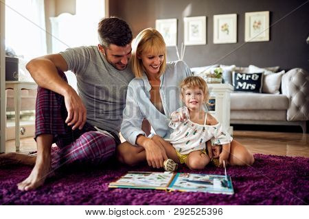 Young family together with daughter enjoying in the morning