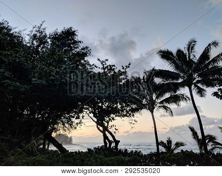 Beautiful Dusk Over The Ocean With Waves Moving To Shore On The North Shore Of Kauai, Hawaii