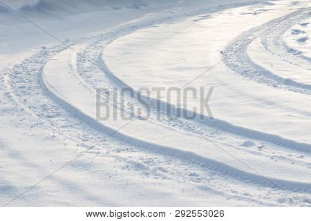 Car Tire Tracks On The Snow Winter