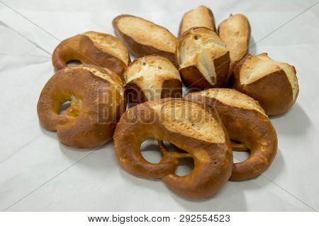 A Pretzel Bread On White Paper Background