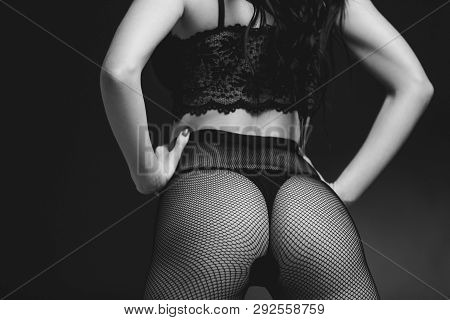 Sexy Butt Woman In Lace Black Sensual Lingerie And Pantyhose On Black Background. Luxury Ass In Stoc